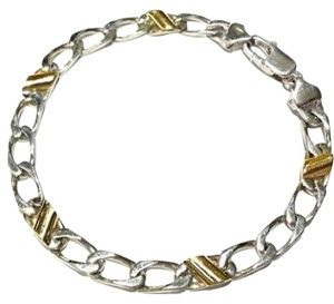Tiffany & Co. Cuban Link Tiffany & Co. 18 Karat Yellow Gold Snd Sterling Silver Bracelet