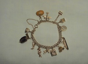 VINTAGE 14 KT GOLD 13 CHARM BRACELET STANHOPE CHURCH OCEAN & MORE