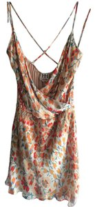 Haute Hippie short dress Orange Silk Floral Mini Cross-back on Tradesy