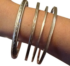 Urban Outfitters Set Of Four Silver Medal Bangles