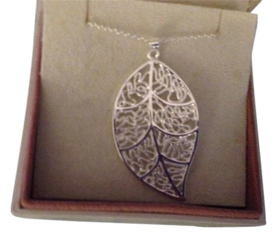 Preload https://item3.tradesy.com/images/sears-silver-free-shipping-filled-18-inch-with-a-leaf-pendant-2-inches-long-matching-earrings-also-n-1957207-0-0.jpg?width=440&height=440