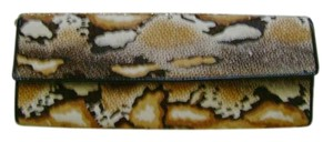 ALDO Gold animal print in black and white and tan Clutch