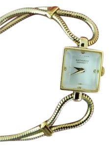 Katherine Hamnett Gold square face and classic style
