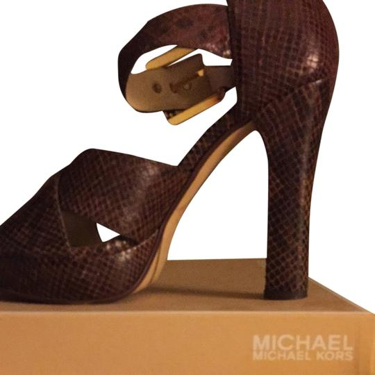 Preload https://item1.tradesy.com/images/michael-by-michael-kors-brown-sandals-1957845-0-0.jpg?width=440&height=440
