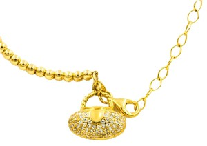 YELLOW GOLD PLATED .925 STERLING SILVER BANGLE WITH CZ PURSE CHARM