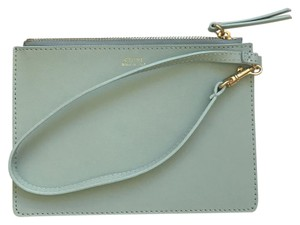 Céline Wristlet in light blue with deep moss