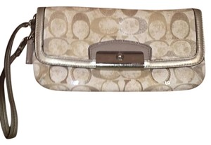 Coach Wristlet in Cream background with shades of tan/brown
