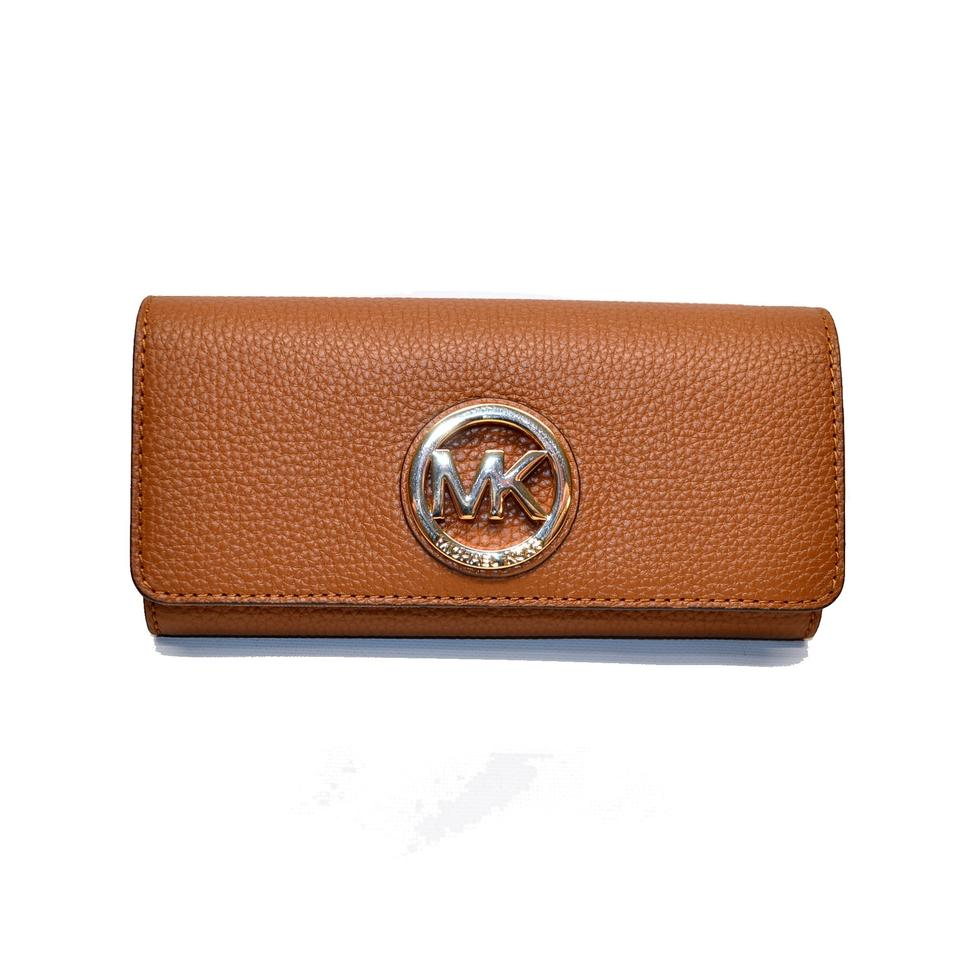 25b629bcd807 Michael Kors Fulton Flap Continental Pebble Leather Wallet Image 0 ...