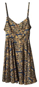 W118 by Walter Baker short dress Blue and gold Summer Fit Flare Colorful Patterned on Tradesy