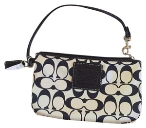 Black and white small Coach clutch with tag Black/white Clutch