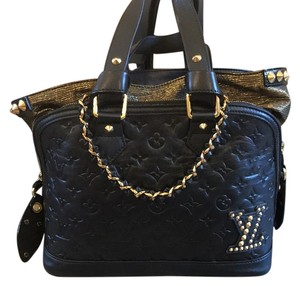 Louis Vuitton Satchel in Black With Gold Accents