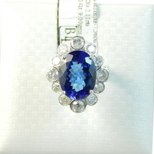 Custom-Made GENUINE LARGE OVAL TANZANITE SURROUNDED BY DIAMONDS