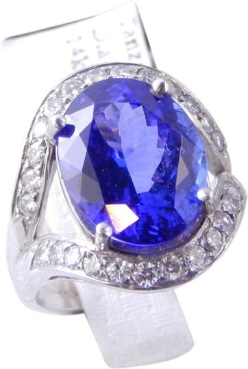 Preload https://item4.tradesy.com/images/white-genuine-large-oval-tanzanite-with-pave-diamonds-flanking-top-and-bottom-of-center-stone-ring-1963548-0-0.jpg?width=440&height=440
