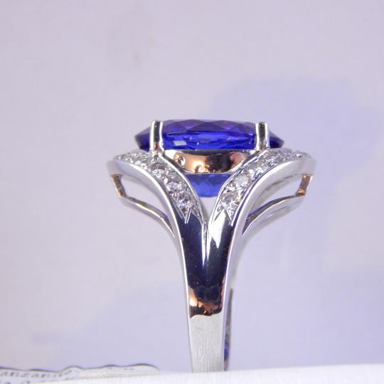 Custom-Made GENUINE LARGE OVAL TANZANITE WITH PAVE DIAMONDS FLANKING TOP AND BOTTOM OF CENTER STONE
