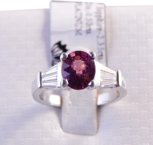 GENUINE OVAL PINK SAPPHIRE WITH TAPERED BAGUETTE DIAMONDS PLATINUM