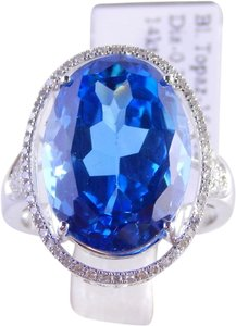 NATURAL LARGE OVAL BLUE TOPAZ SURROUNDED BY MICRO SET DIAMONDS
