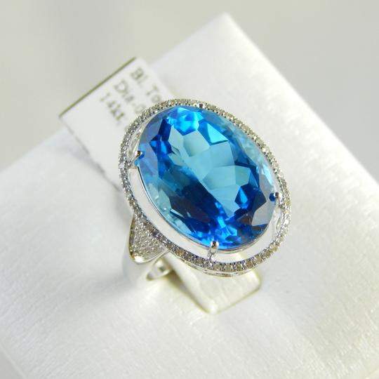 Other NATURAL LARGE OVAL BLUE TOPAZ SURROUNDED BY MICRO SET DIAMONDS