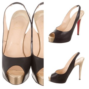 Christian Louboutin Black & gold Platforms
