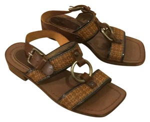 Marni Brown, black, and with silver metal.. Sandals