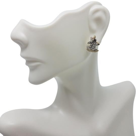 Preload https://item2.tradesy.com/images/chanel-gold-silver-grey-cc-rhinestone-overlapped-piercing-earrings-19645696-0-3.jpg?width=440&height=440