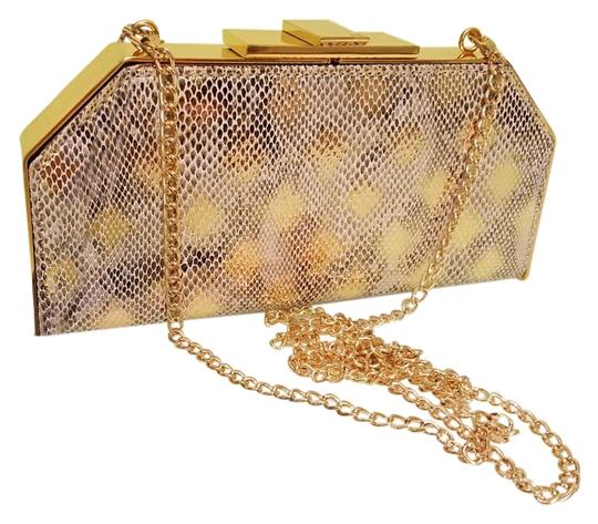 Preload https://img-static.tradesy.com/item/19646362/halston-heritage-embossed-geo-frame-gold-leather-clutch-0-1-540-540.jpg