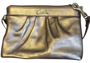 Coach Wristlet in Bronze