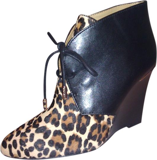 Preload https://item5.tradesy.com/images/coach-blackleopard-print-new-wedge-leather-bootsbooties-size-us-6-1964794-0-0.jpg?width=440&height=440