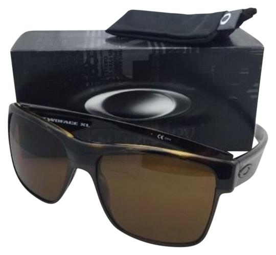 Preload https://item3.tradesy.com/images/oakley-twoface-xl-oo9350-06-brown-tortoise-frame-w-bronze-lenses-w-sunglasses-19648187-0-1.jpg?width=440&height=440