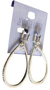 Jennifer Lopez RHINESToNE SILVER TONE PIERCED OVAL HOOP EARRINGS