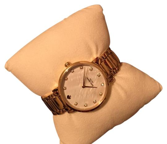 Preload https://item1.tradesy.com/images/kate-spade-gold-band-ivory-face-watch-19650685-0-1.jpg?width=440&height=440