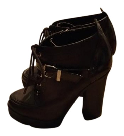 Preload https://item4.tradesy.com/images/circus-by-sam-edelman-black-lace-up-bootsbooties-size-us-75-regular-m-b-19652318-0-1.jpg?width=440&height=440
