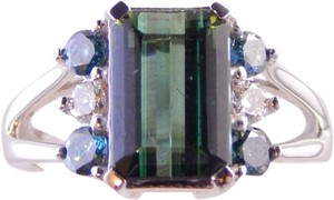Custom-Made EMERALD CUT TOURMALINE WITH WHITE AND BLUE DIAMONDS FLANKING CENTER STONE