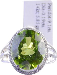 LARGE PERIDOT OVAL RING WITH MICRO SET DIAMONDS