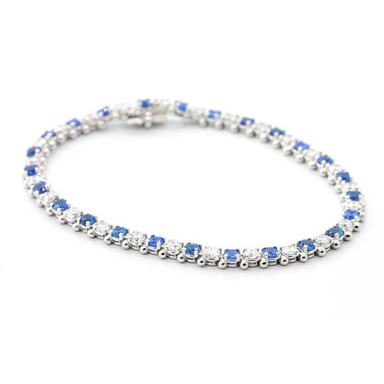 Preload https://img-static.tradesy.com/item/19656283/blue-75-inch-diamond-and-sapphire-tennis-in-14k-white-gold-bracelet-0-0-540-540.jpg