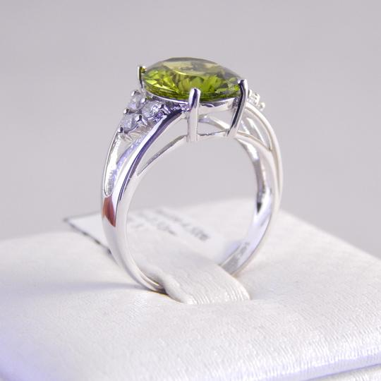 Custom-Made NATURAL OVAL PERIDOT WITH THREE-STONE CLUSTER ON EACH SIDE
