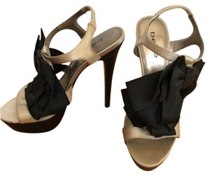 bebe Gold and Black Platforms