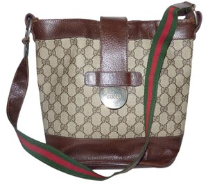 Gucci Replaced Lining Early Style Or Tote Excellent Vintage Satchel in shades of brown coated canvas/leather red/green striped two sided strap