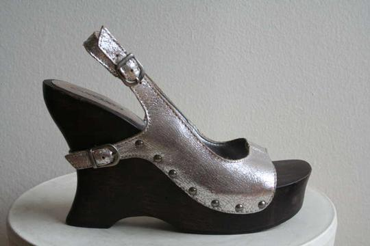 Preload https://item4.tradesy.com/images/xoxo-silverwood-wedges-size-us-75-196683-0-0.jpg?width=440&height=440
