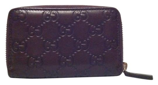 Preload https://item4.tradesy.com/images/gucci-brown-zip-around-card-case-wallet-196748-0-0.jpg?width=440&height=440