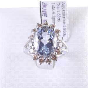 Aqua GENUINE OVAL AQUAMARINE SURROUNDED BY CHAMPAGNE COLOR DIAMONDS