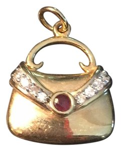 14kt gold charm with diamonds and ruby.