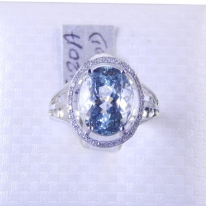 Custom-Made GENUINE OVAL AQUAMARINE WITH HALO DESIGN AROUND CENTER STONE