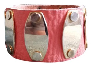 Leather bracelet with button snaps and gold deatils