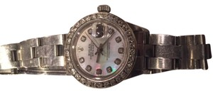 Rolex Womens Rolex oyster diamond bezel and hour marks. Date time adjust.