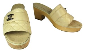 Chanel Beige Cc Leather Logo Quilted Mules
