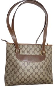Gucci Excellent Vintage Great Everyday Roomy Spacious Unique Satchel Style Early Style Tote in brown large G print coated canvas and brown leather
