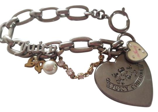 Preload https://img-static.tradesy.com/item/19694963/juicy-couture-silver-and-gold-limited-edition-charm-bracelet-0-1-540-540.jpg