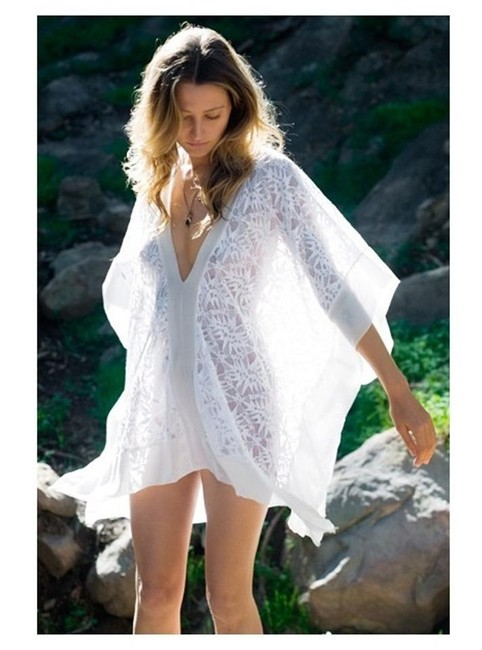 Preload https://img-static.tradesy.com/item/19698923/nightcap-white-jungle-lace-cover-up-caftan-tunic-ponchocape-size-2-xs-0-0-650-650.jpg
