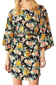 J.O.A. short dress Orange, Green, Black Free People Bell Sleeves Micro-mini Floral on Tradesy