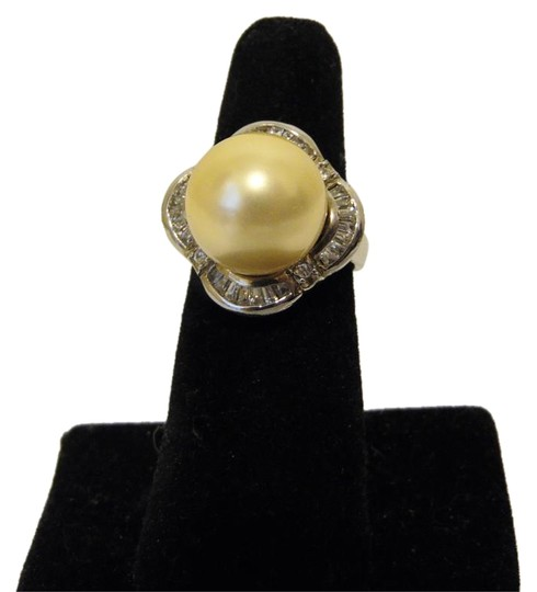 Preload https://item4.tradesy.com/images/pearlfection-925platinum-clad-faux-golden-south-sea-pearl-cocktail-size-7-ring-1970823-0-2.jpg?width=440&height=440